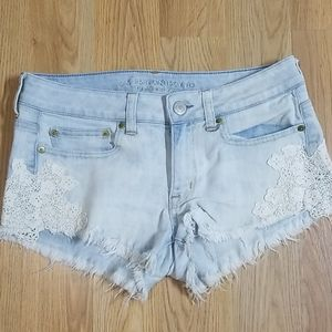 American Eagle lace applique cut off jean shorts